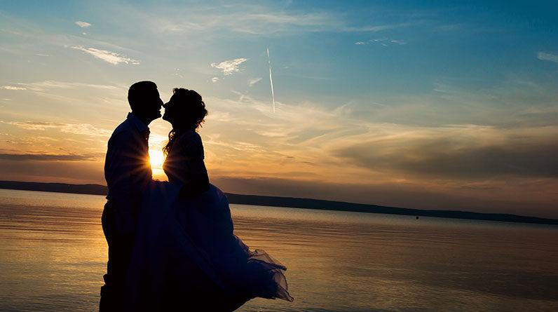 romantic couple kiss sunset