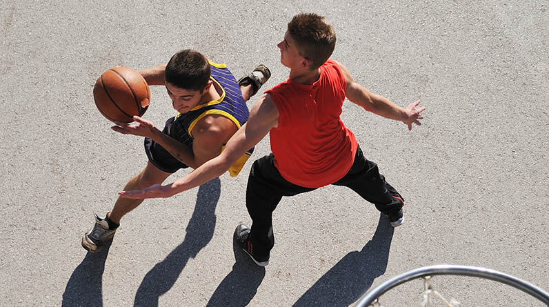 teenagers playing basketball