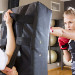 women boxing at the gym